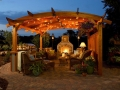 Romantic-Outdoor-Space-Design-Ideas-featuring-DIY-Patio-With-Classic-Rattan-seats-and-coffee-table-also-Stone-Fireplace-and-cool-lighting-ideas