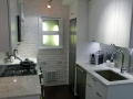 kitchen-fantastic-white-brick-wall-exposed-with-simple-white-plywood-kitchen-cabinetry-set-in-apartment-small-kitchen-decors-2014-best-and-popular-small-kitchen-colection-pictures-945x630