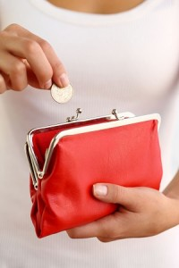 Hands holding red coin purse
